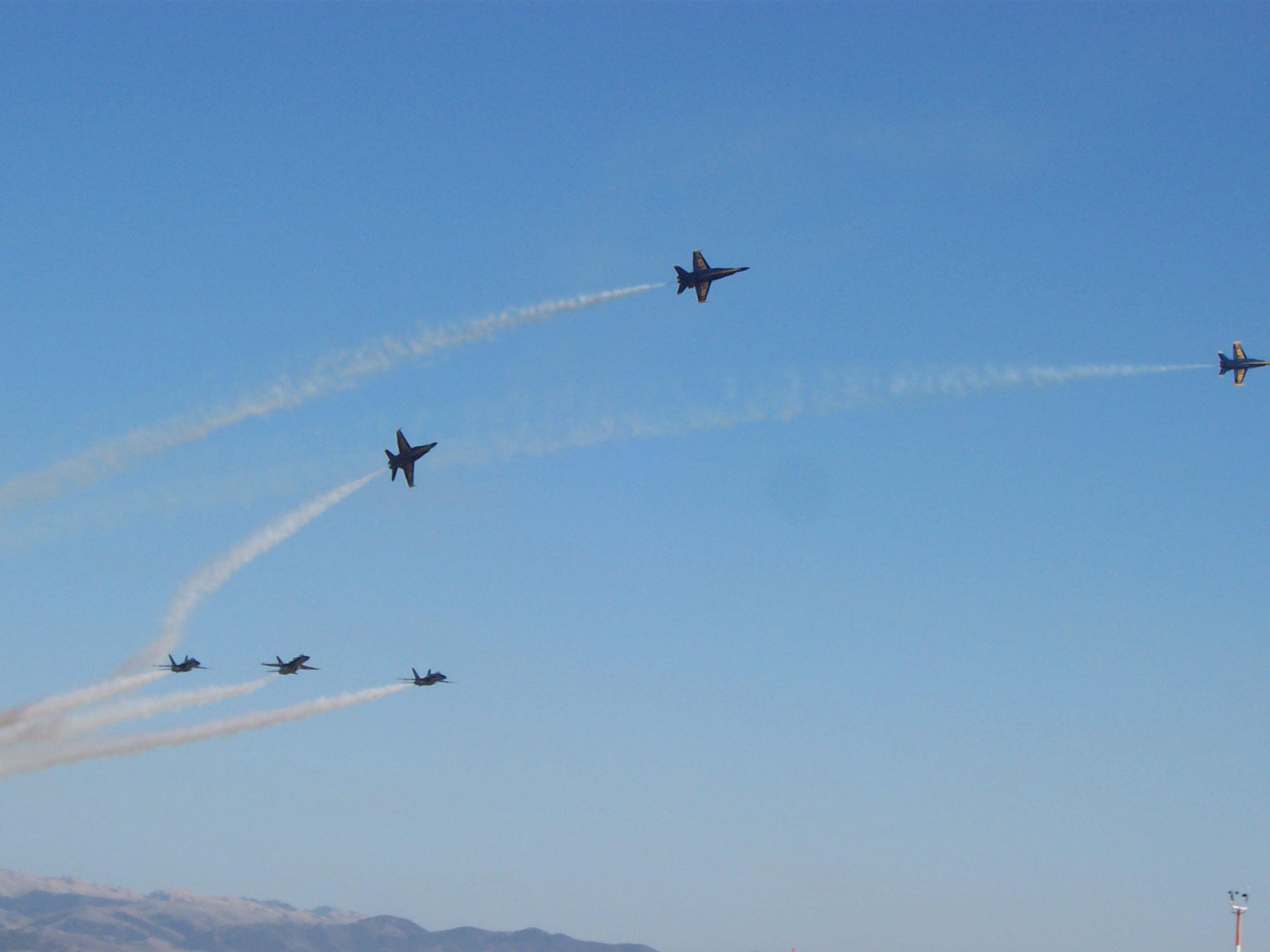 The Blue Angels peel off one by one to go land at the end of the show.  It's a very pretty maneuver.